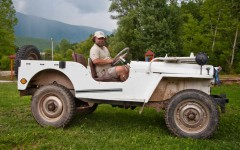 Your guide on the tour, posing in an oldtimer Willys