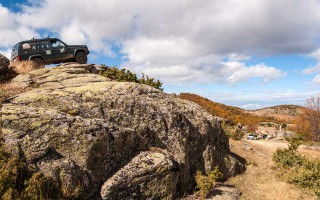 Jeeps climbing rocks