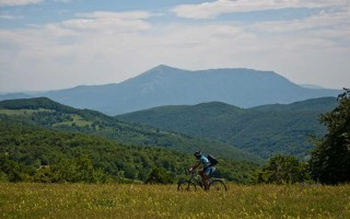 Riding over Malinik with Rtanj mountain in view